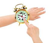 手和像一只手表闹钟 — 图库照片