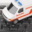 Stock Photo: Computer keyboard and medical car