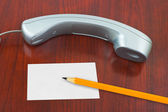 Phone, paper card and pencil — Stock Photo