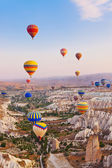Hot air balloon flying over Cappadocia Turkey — Stok fotoğraf