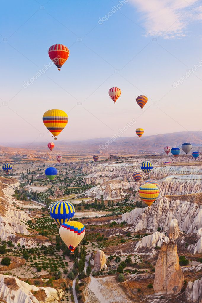 Hot air balloon flying over rock landscape at Cappadocia Turkey — Stock Photo #10623881