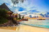 Cafe on tropical beach at sunset — Foto Stock