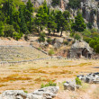 Ruins of stadium in Delphi, Greece - Stock Photo