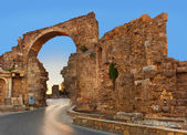 Road and ruins in Side, Turkey at sunset — Stock Photo
