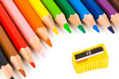 Multicolored pencils and sharpener — Stock Photo