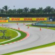 Stock Photo: SEPANG, MALAYSI- APRIL 9: Marshals cletrack for qualificati