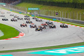 SEPANG, MALAYSIA - APRIL 10: Cars on track at race of Formula 1 — Foto de Stock