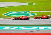 SEPANG, MALAYSIA - APRIL 10: Ferrari cars on track at race of Fo — Stock Photo