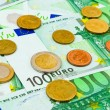 Euro coins and banknotes — Stock Photo #8129607
