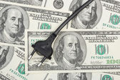 Electric plug on money — Stock Photo