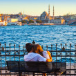 Man and woman on bench at Istanbul Turkey - Stock Photo