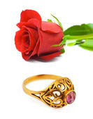Rose and golden ring — Stock Photo