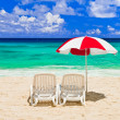 Stock Photo: Chairs and umbrella at tropical beach