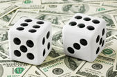 Two dices on money background — Stock Photo