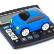 Stock Photo: Calculator and toy car