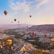 Hot air balloon flying over Cappadocia Turkey - Stock Photo