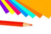 Multicolored paper and pencil — Foto de Stock