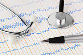 Stethoscope and pen on ecg — Stock Photo