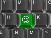 Computer keyboard with smile key — Stock Photo