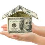 手とお金の家 — ストック写真