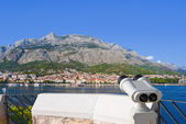 Binoculars and Makarska at Croatia — Stock Photo