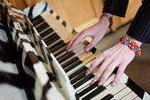 Woman playing piano hands — Stock Photo