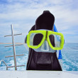 Diving fins and mask on a yacht — Stock Photo