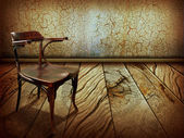 Vintage chair on old wooden floor.Antique background — Stock Photo