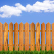 Wood fence and blue sky horizon with clouds in summer day — Stock Photo
