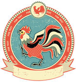Rooster label on old paper texture.Vintage style — Stock Vector