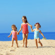 Kids playing at the beach — Stock Photo #10104887