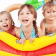 Children playing in swimming pool — Stock Photo