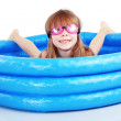 Child playing in swimming pool — Stock Photo #10104903
