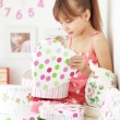 Kid girl with gift boxes — Stock Photo #10228758