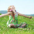 Little girl at green field - Stock Photo