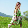 Little girl at green field — Stock Photo #10454835