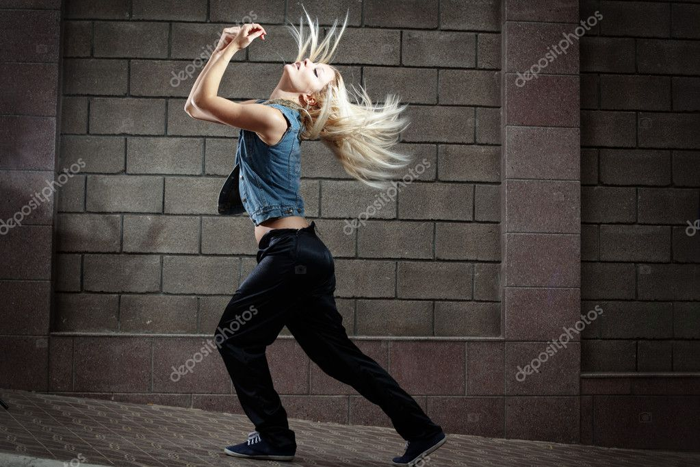 Teenage girl dancing hip-hop over the street wall — Stock Photo #8521828