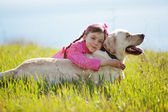 Happy child playing with dog — Stock Photo