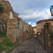 Paved medieval street with ruined house in Savoca village, Sicily — Stock Photo