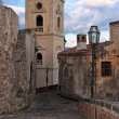 Stock Photo: Paved medieval street with belfry in Savocvillage, Sicily