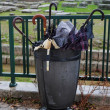 Trash bin full of broken umbrellas — Stock Photo