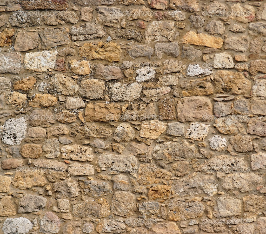 Consistenza del muro in pietra antica foto stock for Pared granate