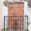 Stock Photo: Old balcony door blocked by brick wall