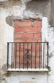 Old balcony door blocked by brick wall — Stock Photo