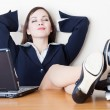 The business woman is relaxing at work — 图库照片