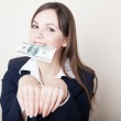 Young woman with 100 dollars in her mouth — Stock Photo #7996355