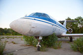 Old russian airplane is on the disused airfield — Stock Photo
