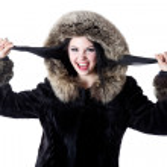 A beautiful woman in a fur-coat — Stock Photo