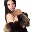 A beautiful naked woman with a fur coat — Stock Photo #8434531