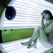 Girl is in a solarium — Stock Photo